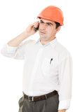 Businessman in helmet on the phone. Royalty Free Stock Images