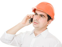 Businessman in helmet on the phone. Royalty Free Stock Photography