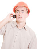 Businessman in helmet on the phone Stock Photography