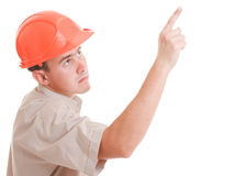 Businessman in helmet pointing up. Royalty Free Stock Photography