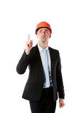 Businessman in helmet pointing up at copyspace Royalty Free Stock Image