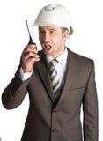Businessman in helmet Stock Photography