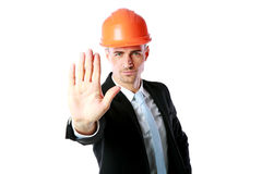 Businessman in helmet showing stop gesture Royalty Free Stock Images