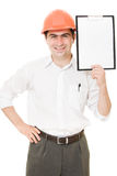 Businessman in helmet shows the blank page Royalty Free Stock Photo