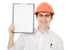 Businessman in helmet shows the blank page Stock Image