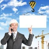 Businessman in helmet Royalty Free Stock Image