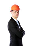 Businessman in helmet standing with arms folded Royalty Free Stock Image