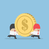 Businessman help his friend carrying big money coin Royalty Free Stock Images