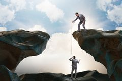 The businessman helping colleague with rope royalty free stock images