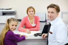 Businessman and her daughter sit in office of realtor. Stock Images
