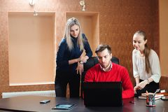 Businessman with her staff, people group in background at modern bright office indoors royalty free stock images