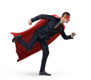 A businessman in a hero red cape and a mask in side view ready to run with one leg already in air on white background. Stock Photo