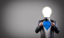 Businessman hero. Businessman super hero with light bulb head have got an idea royalty free stock photo