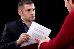 Businessman hidding unfair contract Royalty Free Stock Image