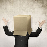 Businessman hide in box Stock Photo