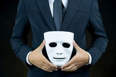 Businessman hide the white mask in the hand
