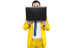 Businessman is hiding behind a computer Stock Photo
