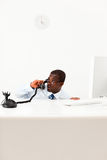 Businessman hiding behind desk. Worried businessman hiding behind desk. Copy space Stock Images