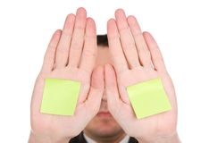 Businessman hiding behind hands Stock Photos
