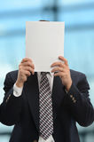 Businessman Hiding Behind Paper Stock Photo