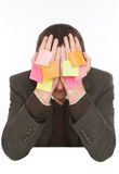 Businessman hiding behind stickers Royalty Free Stock Photography