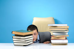 Businessman hiding in the books Stock Photo