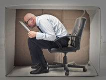 Businessman hiding in a box Royalty Free Stock Images