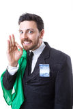 Businessman hiding Brazilian money and the flag of Brazil Stock Photo
