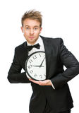Businessman hiding clock Royalty Free Stock Image