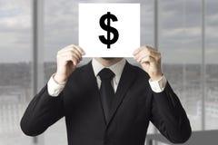 Businessman hiding face behind sign dollar symbol. Businessman in black suit hiding face behind sign dollar symbol stock photos
