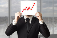 Businessman hiding face behind sign rising bar graph Royalty Free Stock Image