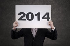Businessman Hiding form The Year 2014 Royalty Free Stock Photo