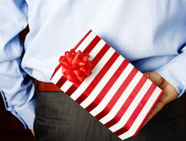 Businessman hiding a gift Stock Photos
