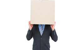 Businessman hiding head with a box Royalty Free Stock Images