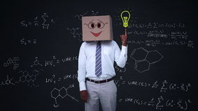 Businessman hiding head with happy box and pointing light bulb stock footage
