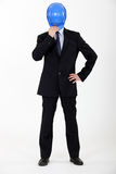 Businessman hiding his face Stock Images