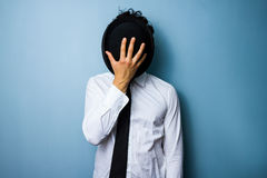 Free Businessman Hiding His Face Behind A Bowler Hat Stock Photo - 32322700