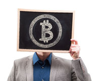 Businessman hiding his face behind bitcoin symbol Royalty Free Stock Images