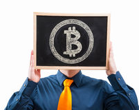 Businessman hiding his face behind bitcoin symbol Royalty Free Stock Photo
