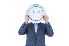 Businessman hiding his face with white clock Royalty Free Stock Image