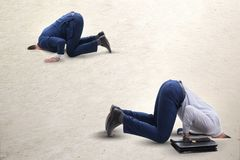 The businessman hiding his head in sand escaping from problems. Businessman hiding his head in sand escaping from problems stock photos