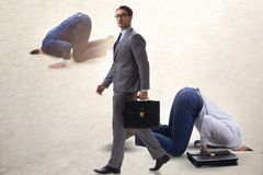 The businessman hiding his head in sand escaping from problems. Businessman hiding his head in sand escaping from problems royalty free stock photography