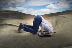 The businessman hiding his head in sand escaping from problems. Businessman hiding his head in sand escaping from problems royalty free stock image