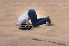 The businessman hiding his head in sand escaping from problems Stock Photography