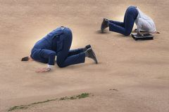 The businessman hiding his head in sand escaping from problems Royalty Free Stock Photography