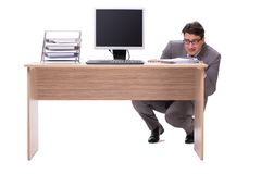 The businessman hiding in the office isolated on white Stock Photos