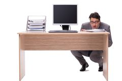 The businessman hiding in the office isolated on white Royalty Free Stock Photography