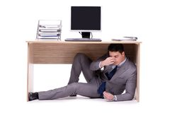 The businessman hiding in the ofice. Businessman hiding in the ofice Stock Photography