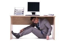 The businessman hiding in the ofice Royalty Free Stock Photo