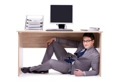 The businessman hiding in the ofice. Businessman hiding in the ofice Stock Photo